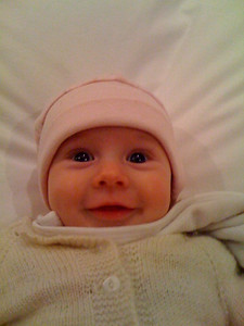 Tricky smiles from the little angel. Scarlett on Daddy's 35th birthday. 4 months old.
