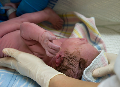 Baby Scarlett Being Cleaned After Birth Before Mum and Dad Hold Her for the First Time