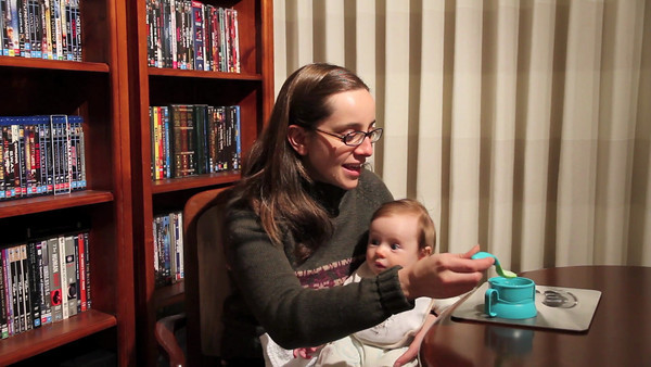 Scarlett's first attempt at eating solid food! Farax and milk - 4 Months Old (June 2012)