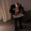 Jeff Hanna, special assistant in university advancement, goes over the evening's script.