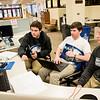 Mason Billings '17, Finn Barrett '17 and Mitchell Brister '16 preparing a group presentation for a finance class.