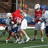 Defenseman Kyle Gifford '18 battles a Denison attacker for the ball on the end line during the Generals' home opener, which the visitors won 13-3.