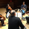 Bennett Lewis '17 and members of the Dali Quartet, guests of Sonoklect, working through his score.