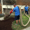 Signs of spring: Facilities Management's mulch crew in the courtyard of Sydney Lewis Hall.