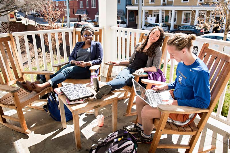 Elizabeth Mugo '19, Audrey Dangler '18 and Alex Dolwick '19 on the Hillel House porch.