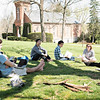 Visiting Instructor of Philosophy, Iris Hu teaches class on there front lawn.