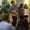 Ralston Hartnett '18 celebrating the release of his EP CD with a performance in the living room of Elrod Commons.