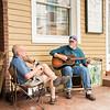 Local Lexington musicians Bo Hughes and Russ Watkins play in front of Blue Phoenix Café.
