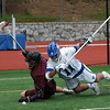 Defenseman Buck Armstrong '16 battling for a ground ball  with a Roanoke attacker on the end line during the de facto ODAC regular season championship, in which the visitors prevailed 14-9.