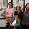 Steven Yeung '17, last year's recipient of the Ju Endowment for Traditional Chinese Studies (left) and family members of the late Professor of Art and Artist-in-Residence I-Hsiung Ju with his newly-installed works in the Center for Global Learning: seated, Ju's widow, Chow-Soon Chuang Ju, standing, daughters Doris and Helen.