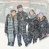Sarah Jane Thielman '16, Austin Pierce '15, Emily Streeper '16, and Katy Bonaro '16 in the snow on the front lawn.