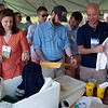 Members of the Class of 1989 examine items from their graduation-day time capsule.