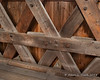 Wooden pegs are used where the trusses overlap and are joined together, while steal bolts are also used to help keep things tight against each other