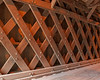 This bridge uses a town lattice truss structure with overlapping planks used for the trusses