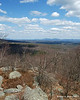 Pack Monadnock can be seen off in the distance from the open rocky area near the summit