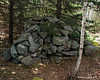 The cairn is probably at least 4 feet tall and 6-8 feet wide