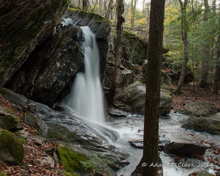 The water flowing between the rocks