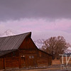 a December sunrise, over the Mormon barn with the Tetons in view