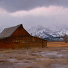 a low cloud ceiling over the Tetons as seen from the Morman Barn