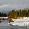 a December sun warms the banks of the Snake River, Tetons