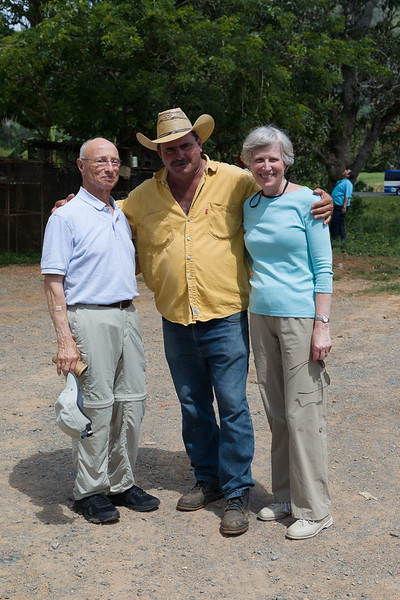 Bob & Sally Mooney with the tobacco farmer, who people think resembles Burt Reynolds.