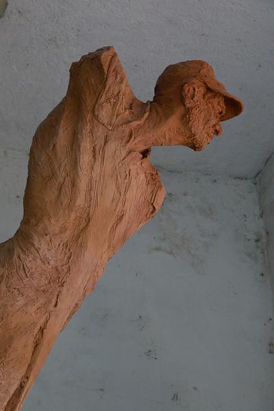 Reddish, capped sculpture