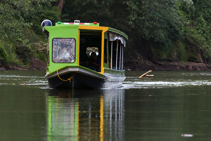 A riverboat making its way up the Sarapiqui River