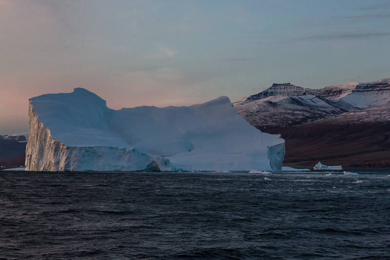 9/13/15, 6:37 AM.Earky morning light hits a large iceberg as we approach Storoen Island.