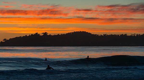 Surfing at sunset, Carmel, California