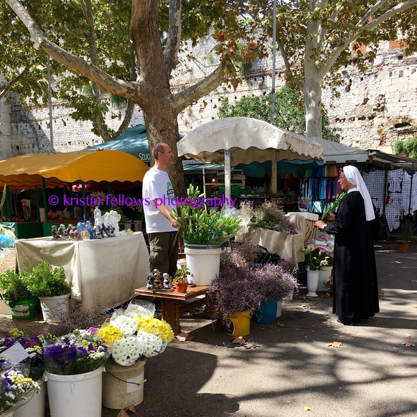 a nun buying flowers, split
