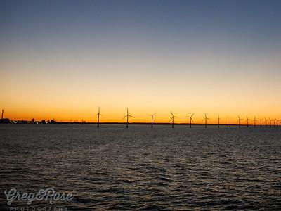 Sunset and Windmill Power Generators