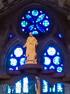 Not suer of the sculpture is but it is set high inside the Basilica in front of a beautiful set of windows