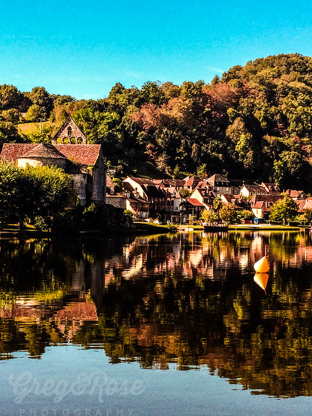 Church water and Village of Beaulieu Sur Dordogne