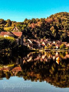 Church water and Village of Beaulieu Sur Dordogne
