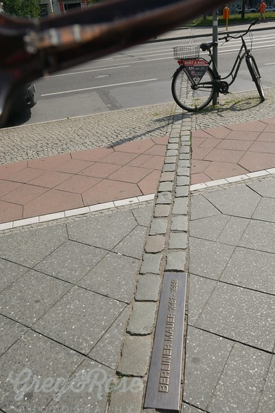 Cobbles mark where the Berlin wall was