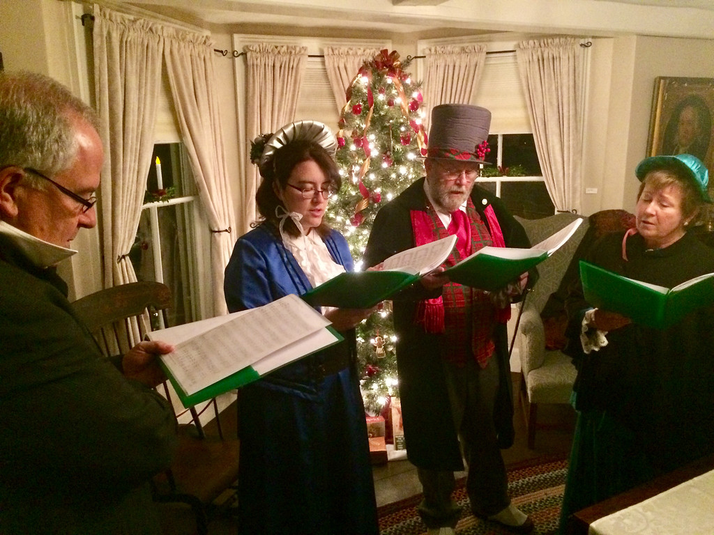 . Gary Douglas, Beth Douglas, David Kinzel and Peggy Kinzel sang songs of the season at the Clara Sexton House in Billerica. Photo by Mary Leach