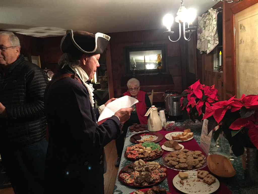 . Bill Brimer of Tewksbury, captain of the Billerica Colonial Minute Men, enjoyed a snack at the Billerica Historical Society\'s open house held at the Clara Sexton House. Photo by Mary Leach