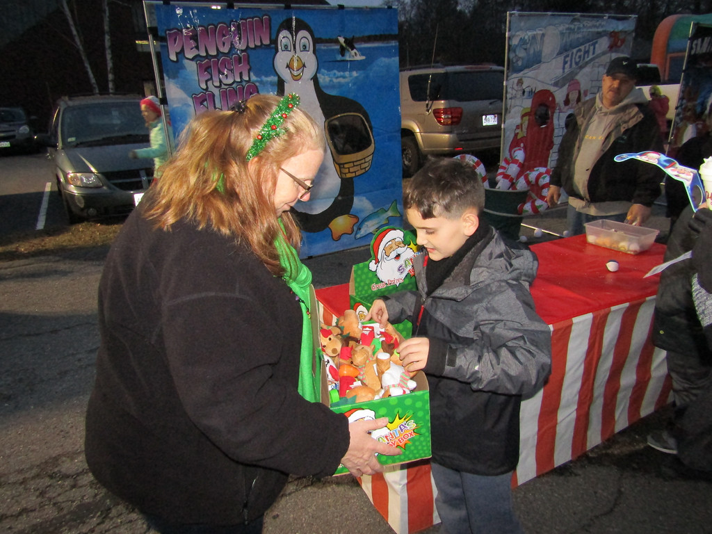 . A child selected his prize at the winter festival. Everyone who played a game was a winner. Photo by Mary Leach