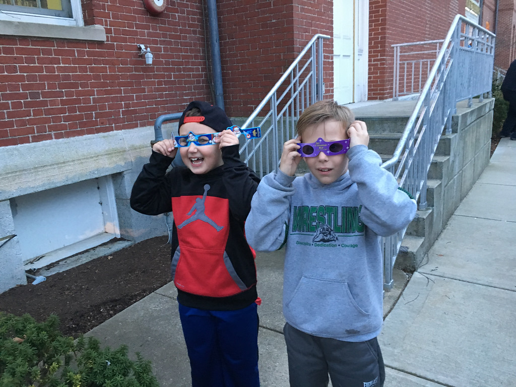 . Nicholas Cloutier, and Doug Skane, both of Billerica, enjoyed a new view of the holiday lights with 3-D glasses they got from the Billerica Library. Photo by Mary Leach