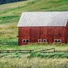 landscape with a red barn in rural Montana and Rocky Mountains