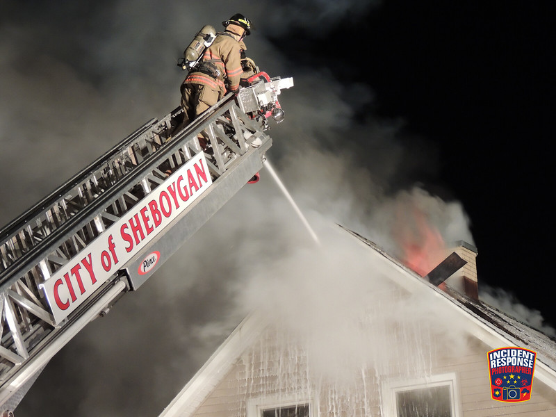 Firefighters battled a house fire in the 1600 block of Washington Avenue in Sheboygan, Wisconsin on Sunday, February 2, 2014. Photo by Asher Heimermann/Incident Response.