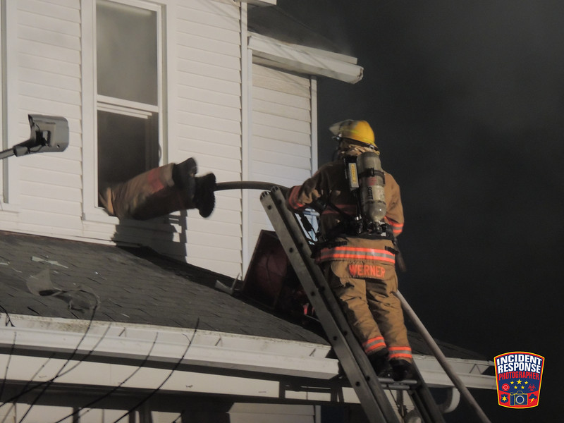 Firefighters work to put out a fire at 1527 North 12th Street in Sheboygan, Wisconsin on Saturday, March 15, 2014. Photo by Asher Heimermann/Incident Response.