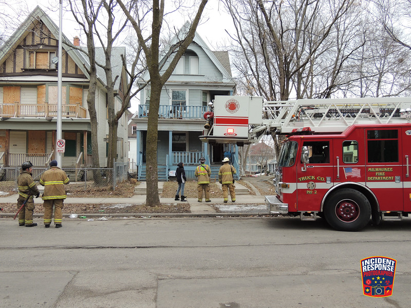 Firefighters responded to a house fire near North 32nd Street & Juneau Ave in Milwaukee, Wisconsin on Saturday, March 22, 2014. Photo by Asher Heimermann/Incident Response.