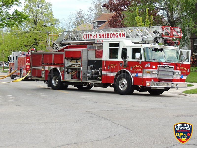 Firefighters responded to a house fire with a person trapped at 632 Michigan Avenue in Sheboygan, Wisconsin on Monday, May 26, 2014. Photo by Asher Heimermann/Incident Response.