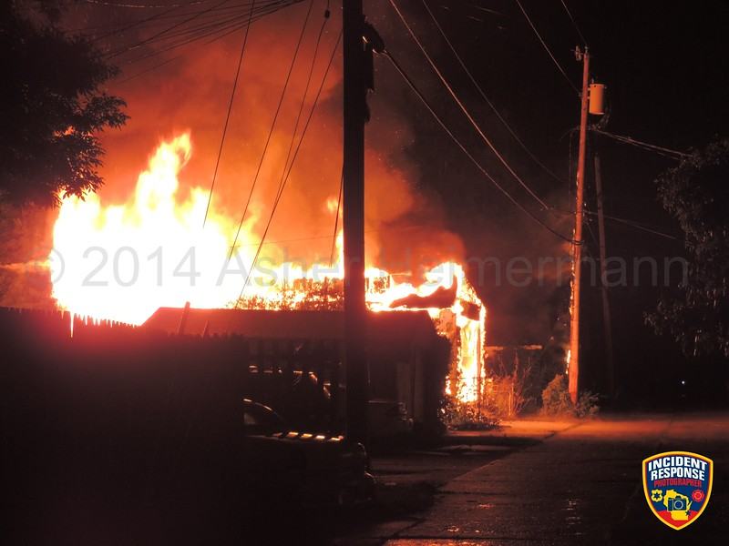 Firefighters responded to a fully engulfed garage fire at 922 Georgia Avenue in Sheboygan, Wisconsin on Friday, June 20, 2014. Photo by Asher Heimermann/Incident Response.