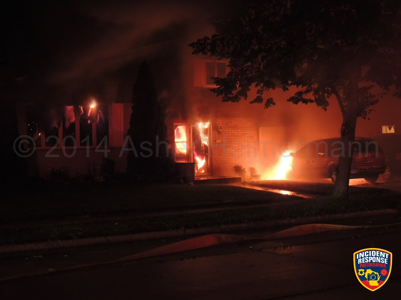 The Sheboygan Fire Department responded to a house fire at 1540 Ohio Avenue in Sheboygan, Wisconsin on Saturday, July 12, 2014. Photo by Asher Heimermann/Incident Response.