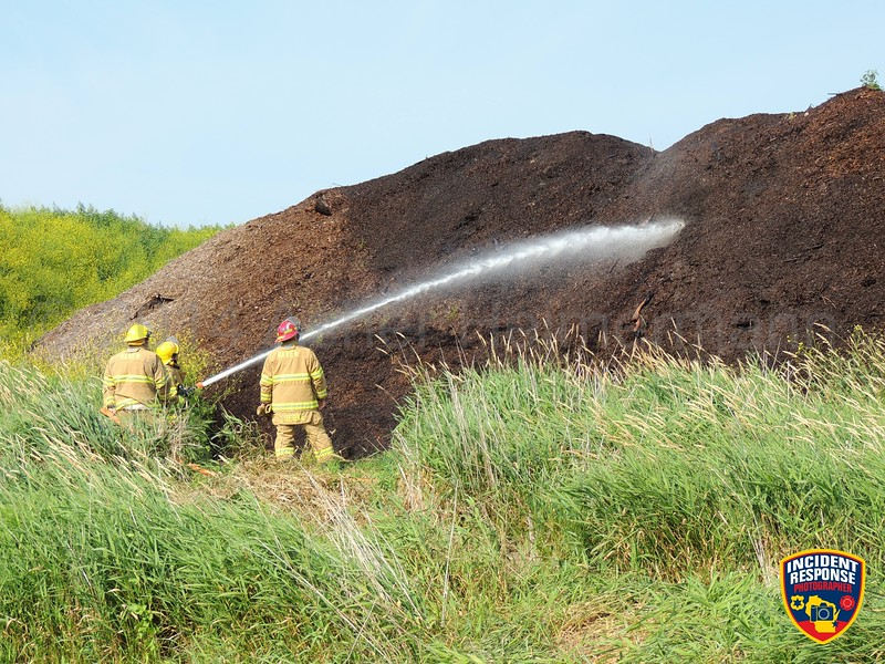The Haven Fire Department responded to a mulch pile fire at Steve B's Landscaping at Playbird Road & Lakeshore Drive in Sheboygan, Wisconsin on Sunday, July 20, 2014. Photo by Asher Heimermann/Incident Response.