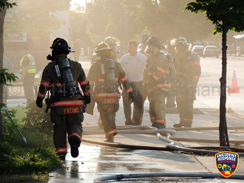 Firefighters responded to a house fire at 1108 Indiana Avenue in Sheboygan, Wisconsin on Monday, July 28, 2014. Photo by Asher Heimermann/Incident Response.