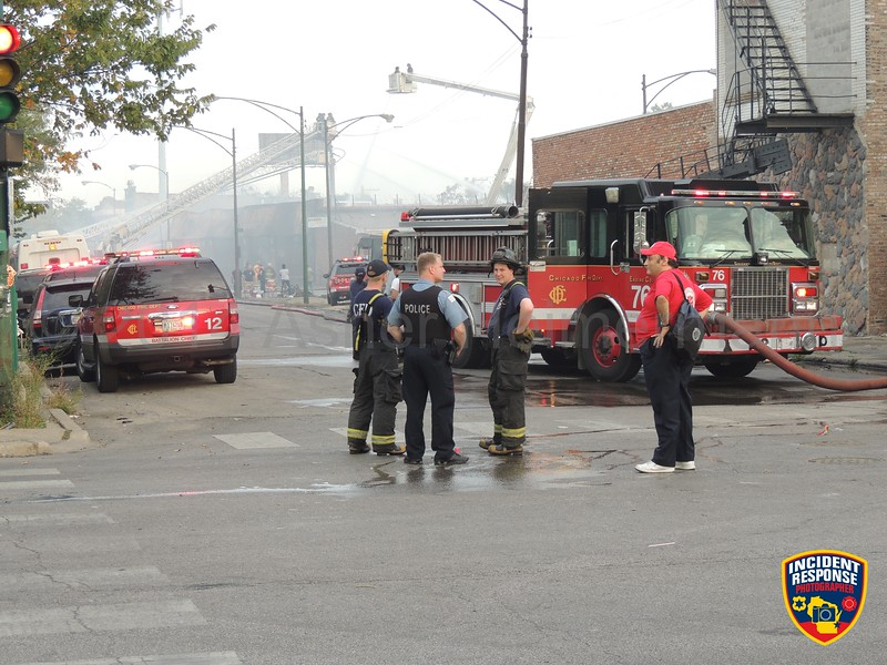 Firefighters on scene of a 3-11 alarm warehouse fire at 3909 West Harrison Avenue in Chicago, Illinois on Thursday, September 25, 2014. Photo by Asher Heimermann/Incident Response.