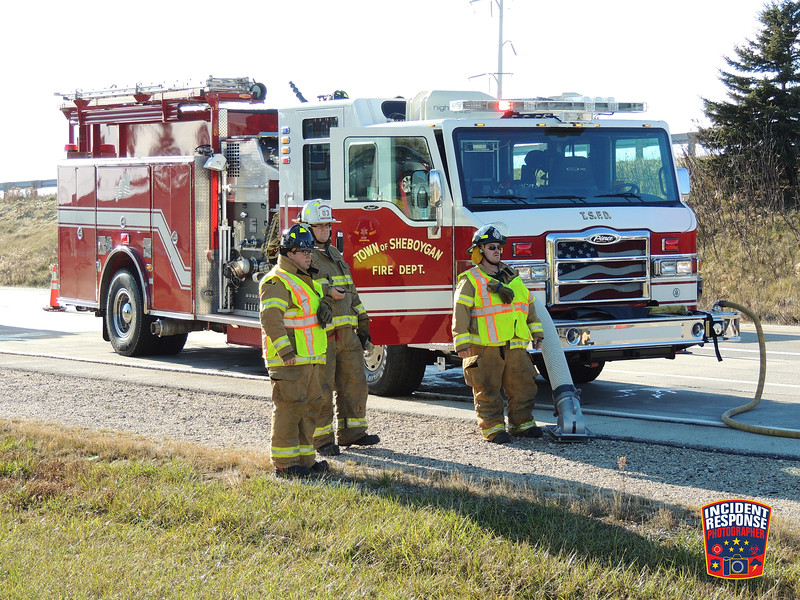 The Town of Sheboygan Fire Department responded to a vehicle fire on the Interstate 43 northbound off-ramp to Highway 28 in Sheboygan, Wisconsin on Sunday, November 29, 2015. Photo by Asher Heimermann/Incident Response.